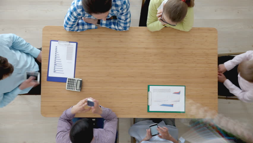 Group of people in casual clothes working with laptop and financial documents | Shutterstock HD Video #23584708