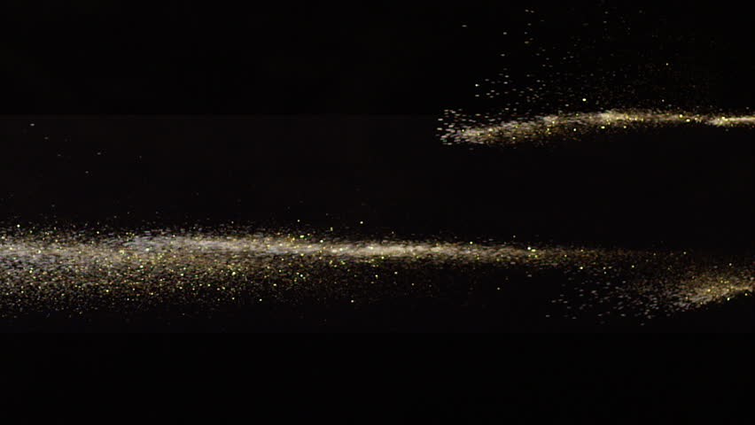 Falling real golden dust from right to left on black background. This footage can be used on first plan of different videos by blend modes Overlay or Screen. Shot on RED camera .