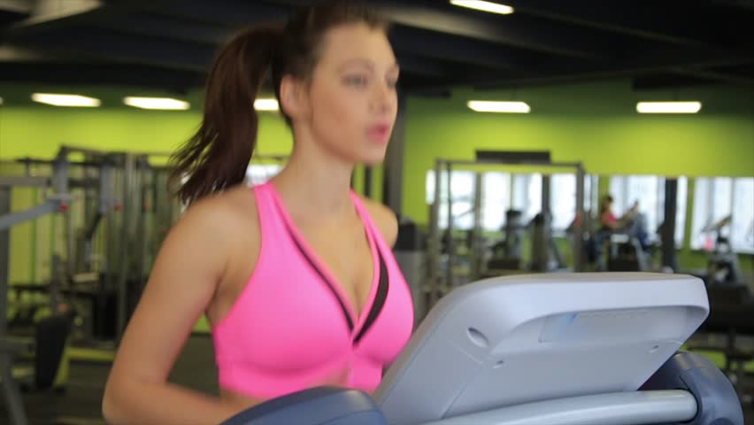 Attractive young girl running on the treadmill in the gym. Fitness concept. Slow motion. | Shutterstock HD Video #23630374