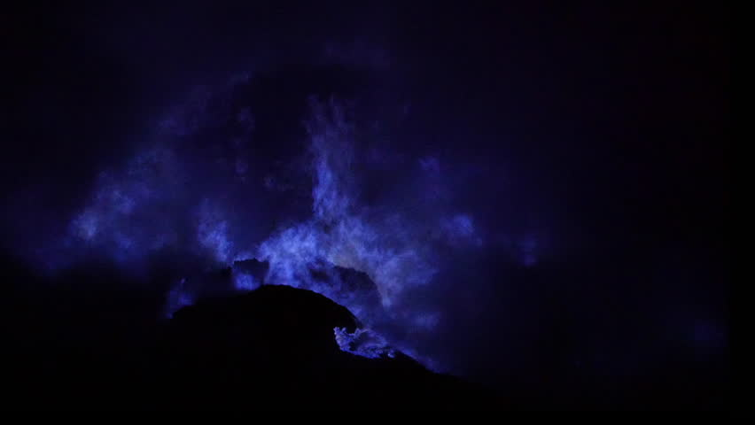 Blue fire burning inside the crater of Kawah Ijen volcano, East Java, Indonesia.
