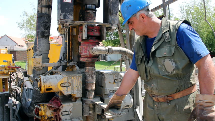 Oil worker drilling for oil on rig. Oil and gas industry. Petroleum worker at work. Drilling rig. Power and energy.