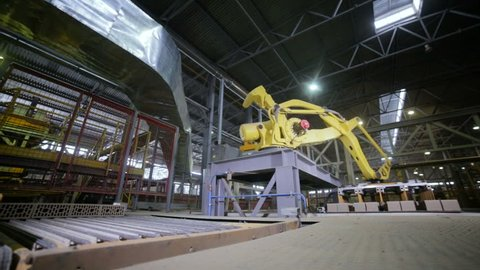 Modern Industrial automation. Robotic Arm Assembling products. Timelapse.