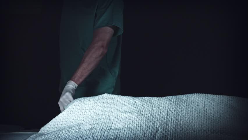 4K Crime Morgue. Mortician Examining Dead Body