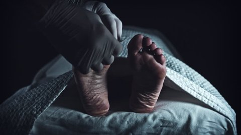 4K Morgue Dead Body, Mortician Place Unidentified Tag on Foot