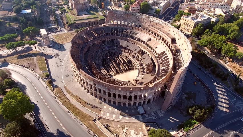 Aerial Colosseum flying near structure also known as Coliseum or Flavian Amphitheatre or Colosseo oval amphitheatre centre Rome Italy largest amphitheatre popular tourist attraction in Italy Europe 4k