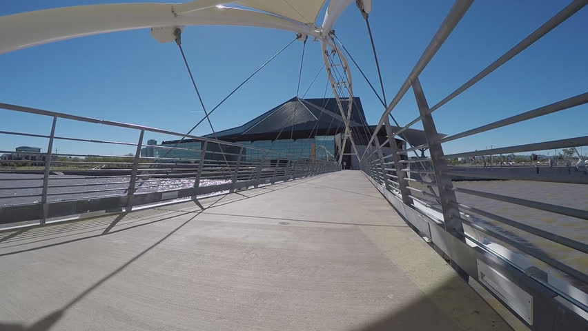 TEMPE AZ/USA: January 30, 2017- Tilt shot of the pedestrian bridge at Town Lake Center For the Arts. A modern looking bridge crosses the Salt River and leads to a popular local entertainment venue. #23723758