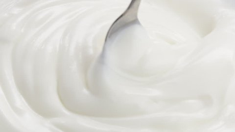 Slow motion of mixing yogurt with spoon, 180fps prores footage