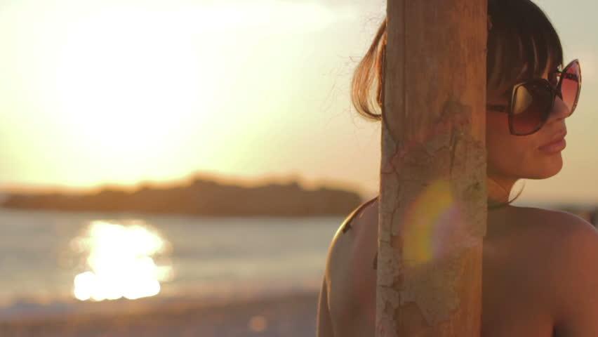 Portrait of a beautiful woman in bikini on the beach.