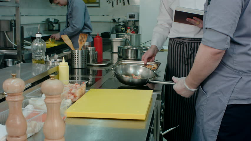 Restaurant Kitchen Video chef in the restaurant kitchen ; cook in the restaurant's kitchen