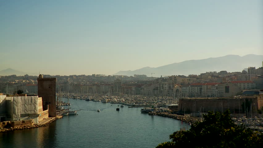 Marseilles, France - CIRCA October 2009: Large panoramic view of Marseille's cityscape; view of the port and sailboats. | Shutterstock HD Video #23792608