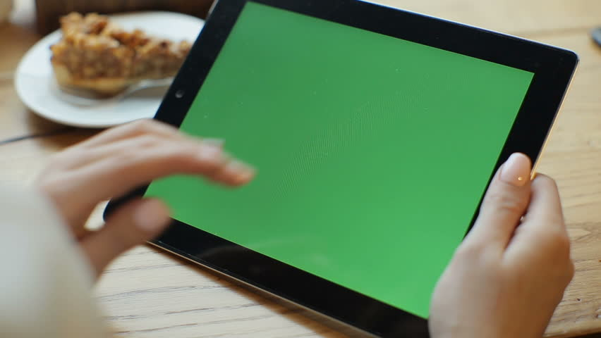 Businesswoman using tablet computer with green touch screen in cafe   Shutterstock HD Video #23824381
