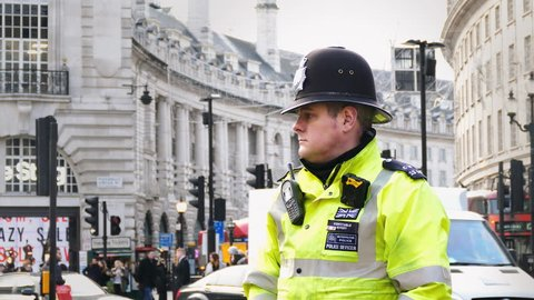 LONDON - JAN 18: British policeman bobby officer working on duty in London, England on January 18, 2017. Like other UK police forces, City of London police officers are not routinely armed with guns.