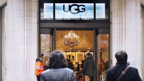LONDON - JAN 24: UGG Australia brand retail shoe store open for business on January 24, 2017. UGG is an American footwear company that is best known for its sheepskin fashion boots for men and women.