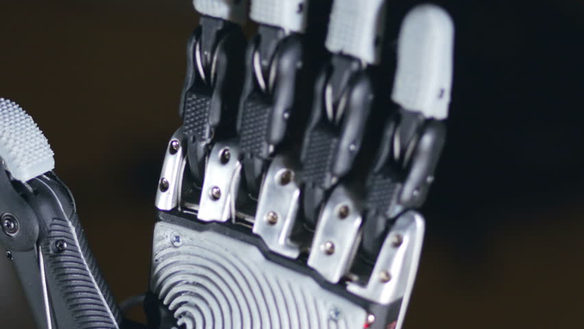 Futuristic robotic cyborg arm in action. Real robotic prosthesis.