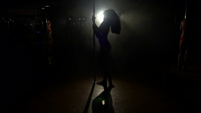 spooky lighting. sexy girl with flying hair pole dance dancing hd stock video clip spooky lighting c