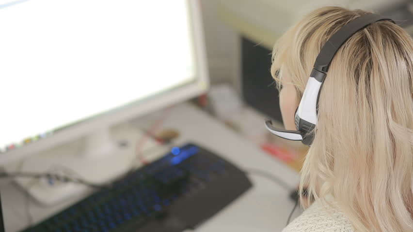 Close-up of business woman talking on headset in a call center | Shutterstock HD Video #23952838