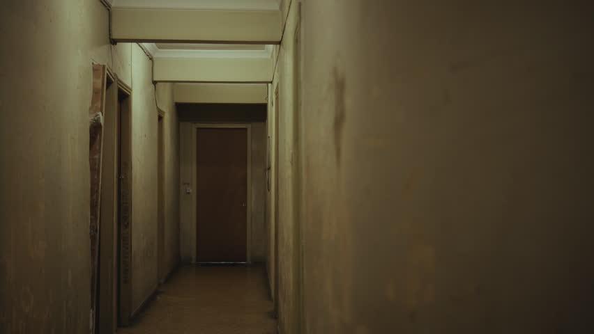 Apartment Building Hallway walking inside a long dark hallway of an old apartment building