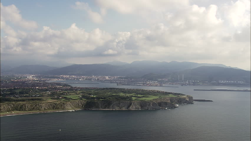 Entrance To Getxo Harbour And Ship Waiting At Anchor