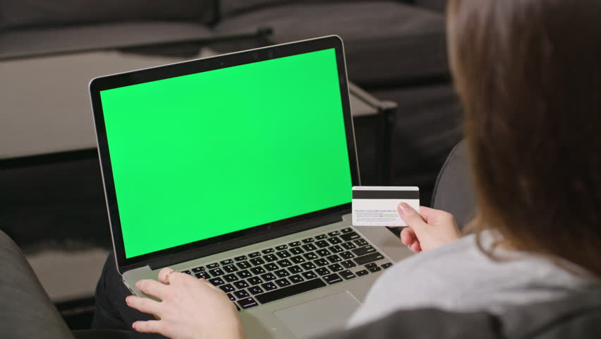 Close-up view of young woman online shoping at home on pc, typing credit card number | Shutterstock HD Video #23996938