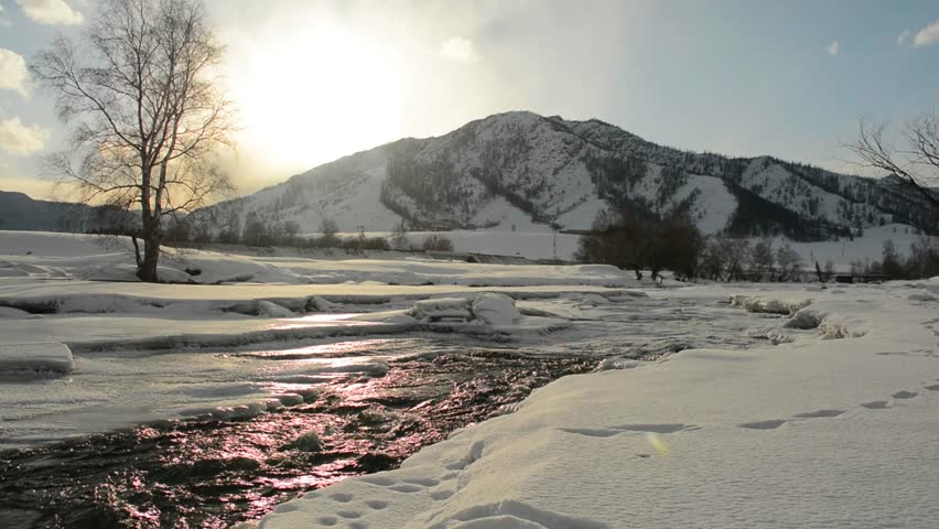 River flow. Glitter in the sunset. The cold winter in the mountains. | Shutterstock HD Video #24028618