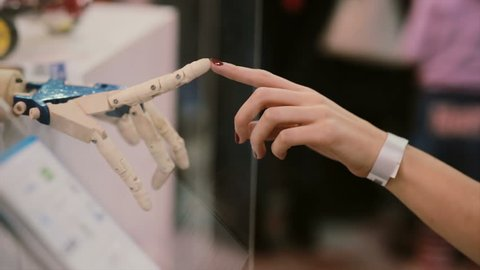 Touching hands of human and cyborg or The Creation of cyborg.