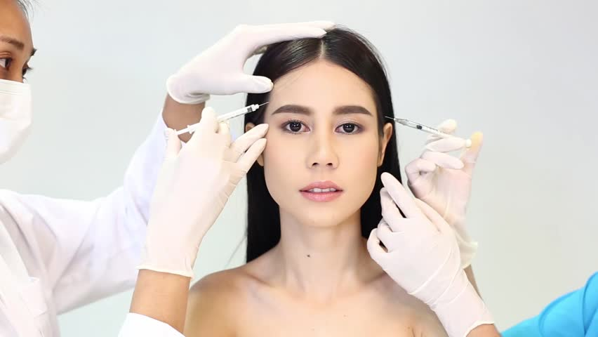 Doctor and Nurse casting spell and make woman more beautiful with beauty chemical injection before plastic surgery, hands on work group together concept, dolly slider from right to left