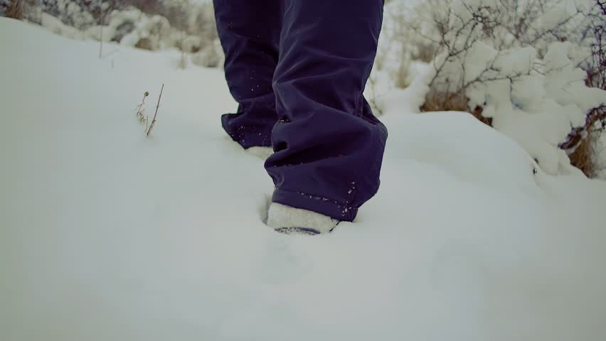 Slow motion. walk man with backpack feet steps in snow winter landscape close up | Shutterstock HD Video #24078988