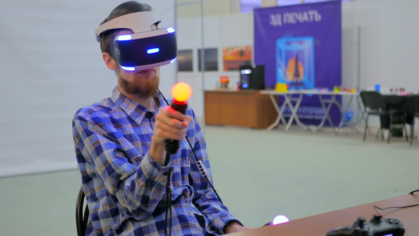 fed0211db82d Exhibition of modern technologies. Virtual reality game. Young man using virtual  reality glasses. VR