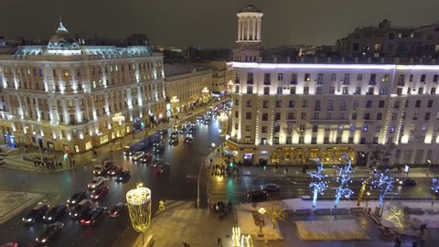 Pushkinskaya square holiday decoration tverskaya street. Night lights illumination. Aerial drone flight. Moscow Russia cowered in snow and ice. Happy people walk the street. New year city road traffic