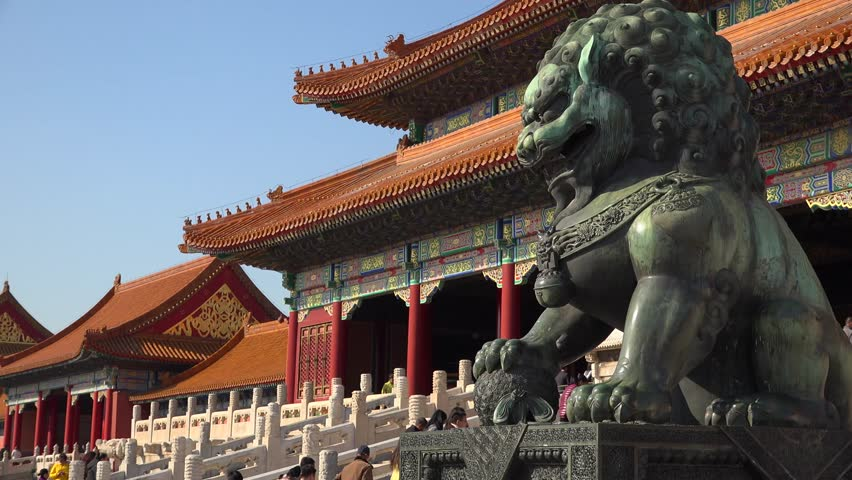 Epic green Chinese Imperial guardian lions. Forbidden city Beijing capital of China. Emperor palace. Old Asian culture. Beautiful summer day, Blue sky. Cinematic 4K.