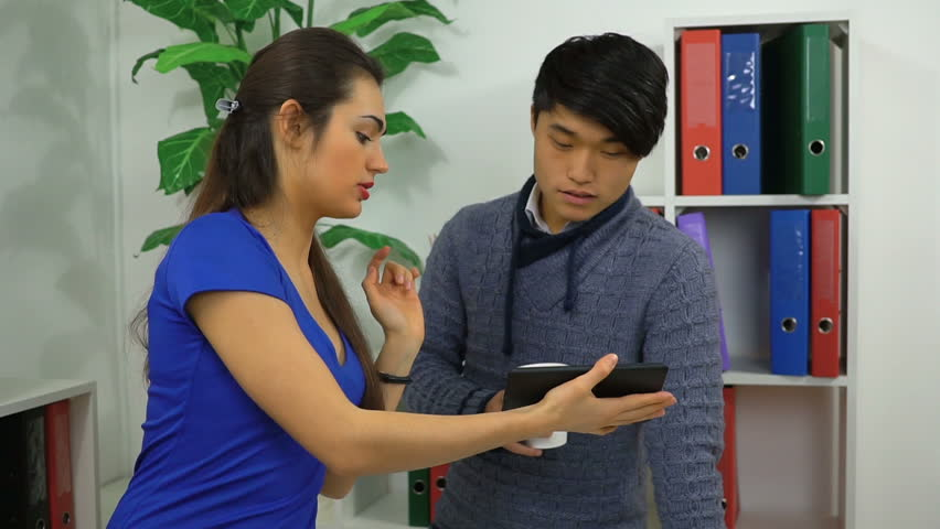Workers discuss work issues using the tablet   Shutterstock HD Video #24160618