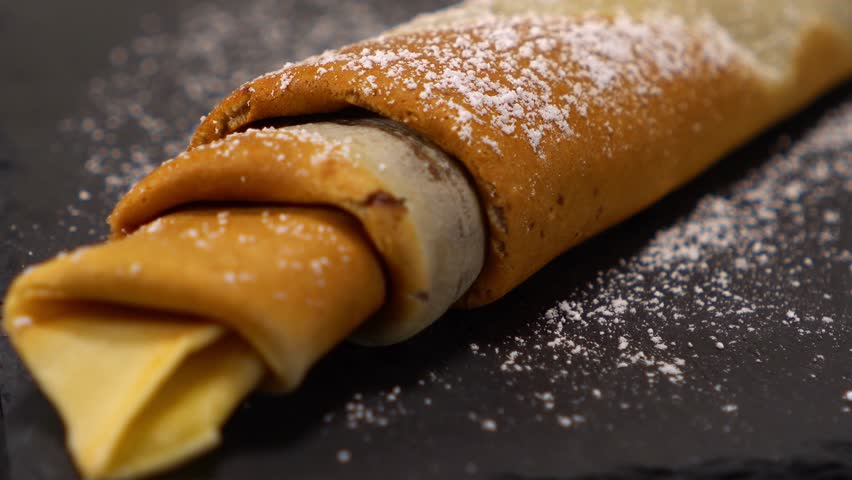 A speciality from France - French Crepes or pancakes with chocolate   Shutterstock HD Video #24200908