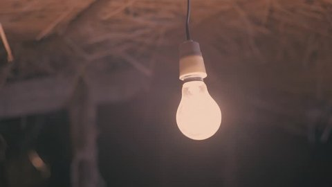 Bulb flickering in slow motion in a small village, Tando Jam, Pakistan