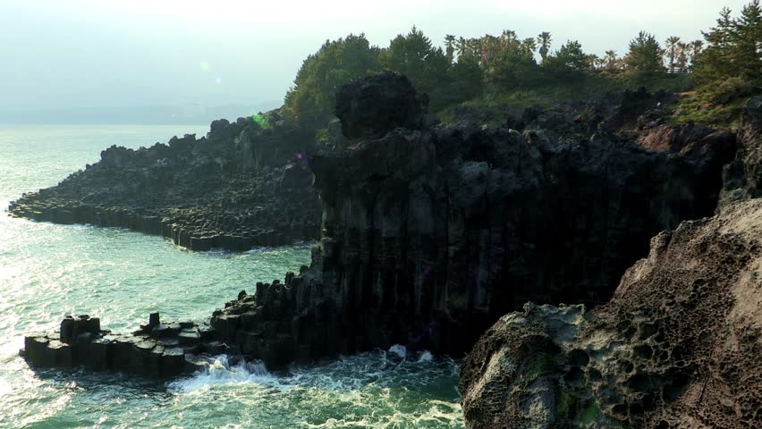 a view of the ocean and rocks and cliff on Jeju island