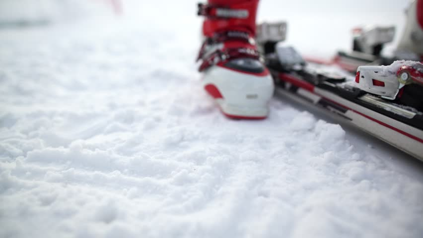Fixing the ski boot. Skiing close up.