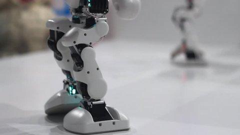 Robotic legs dancing. Close up of robot dancing feet. Robot legs dance. Robot dance concept. Robotic technology. Mechanical legs dance. Humanoid robot feet dance