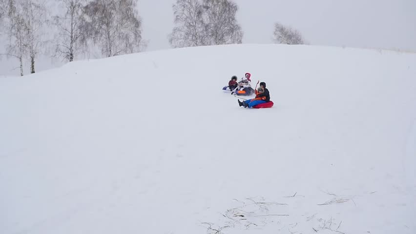 Happy family rides and smiling snowtube on snowy roads. slow motion. snow winter landscape. outdoors sports | Shutterstock HD Video #24248678