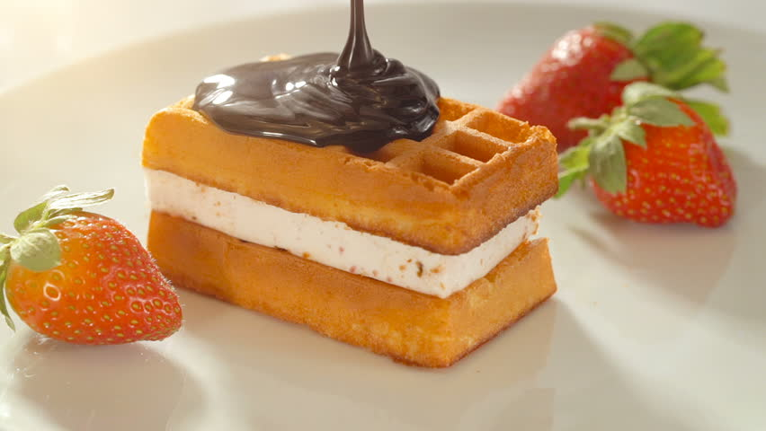 Vienna, belgian waffles with strawberry and chocolate topping