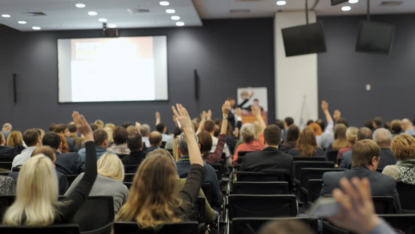 Business people Raising there Hand Up at a Conference to answer a question 4k.