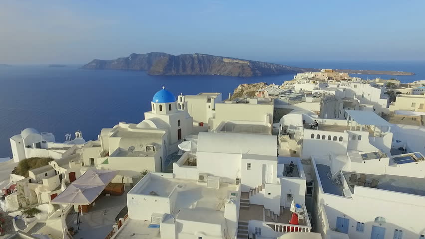Aerial view flying over city of Oia on Santorini Greece HD