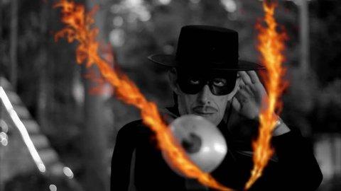 Fencing battle Zorro. Man in mask with sword drawing fire letter V.  vendetta, revenge, battle, conflict. Sign, symbol, fire