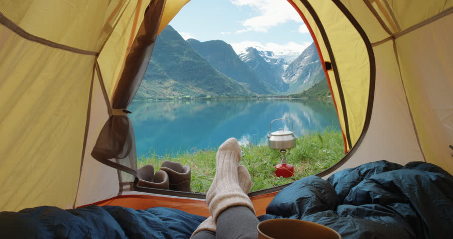Camping woman lying in tent Close up of Girl feet wearing hiking boots relaxing on vacation POV | Shutterstock HD Video #24370088