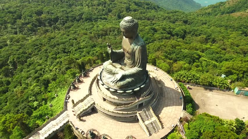 Big Buddha in Hong Kong, She poured in bronze and depicts Buddha seated, China, Hong Kong, Aerial drone flight towards the peaceful Tian Tan bronze Buddha statue.