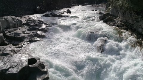 Drone Flying Over Stunning River Waterfall with White Water Rapids in Ultra Real 4K Nature Shot