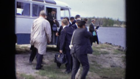 MOSCOW RUSSIA 1971: group of men about to get onto ferry.