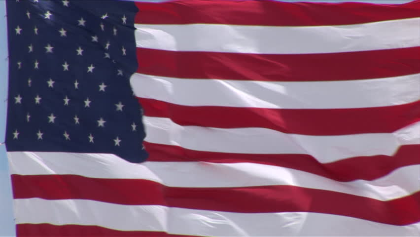 Close-up of US National Flag flapping in the wind in a Ghost Town of South Dakota United States