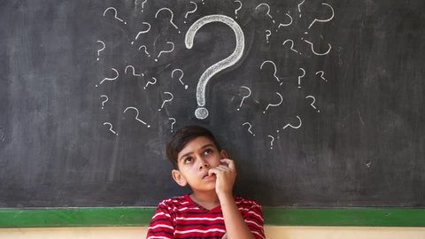 Concepts on blackboard at school. Young people, quiet student and pupil in classroom. Hispanic boy with doubts and thoughts in class. Portrait of male child thinking
