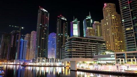 8K Dubai Marina night time lapse, UAE. Dubai Marina - the largest man-made marina in the world, is a canal city, carved along a 3 km stretch of Persian Gulf shoreline. Dubai 8K 7680x4320 Timelapse