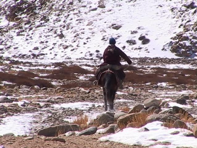 Horseman nomad riding in the remote area between Tibet and the Himalayas