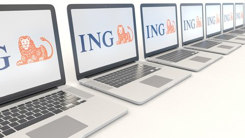 Modern laptops with ING Group logo. Computer technology conceptual editorial 4K clip, seamless loop